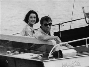 Richard Burton and Elizabeth Taylor arrive June 15, 1962, in a motor launch at the small town Porto d'Ischia, on the isle of Ischia in the Gulf of Naples, Italy for the shooting of some scenes of