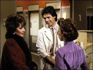 Elizabeth Taylor, portraying Helena Cassadine, left, and Rick Springfield, portraying Dr. Noah Drake, center, are shown on the set of the ABC daytime series,