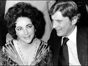 Actress Elizabeth Taylor and her husband, former secretary of the U.S. Navy John Warner, at the 42nd New York Film Critics Circle Awards dinner in New York in this Jan. 30, 1977 file photo.