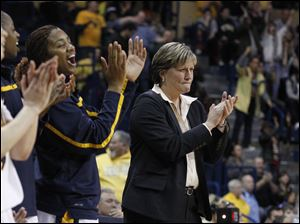 Toledo head coach Tricia Cullop, right, and the Rockets bench applaud their team during second-half play.