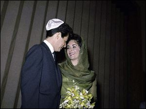 Eddie Fisher stands with his wife Elizabeth Taylor after their marriage in Las Vegas in this May 12, 1959 file photo.