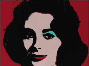 This photo released by Sotheby's shows a 1963 painting by Andy Warhol of Elizabeth Taylor titled