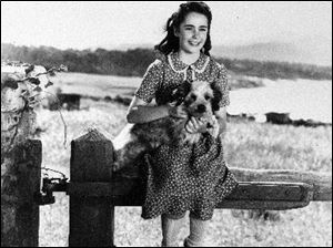 In a 1944 file photo, young actress Elizabeth Taylor is seen during filming of