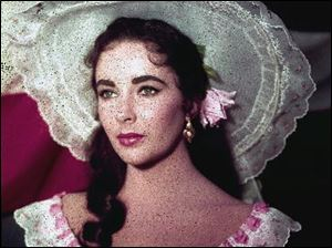 In this 1957 file photo, actress Elizabeth Taylor is shown in costume for her character in the film