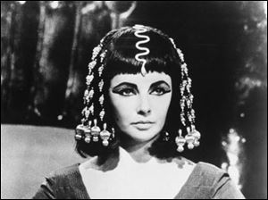 In this 1963 film still image originally released by 20th Century Fox, actress Elizabeth Taylor portrays Cleopatra in this photo from Joseph L. Mankiewiez' 1963 film,
