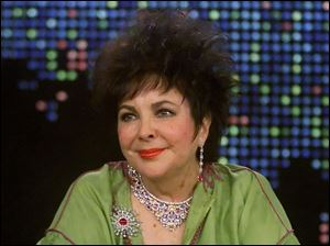 Actress Elizabeth Taylor appears during an exclusive interview with talk show host Larry King on CNN's