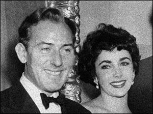 Actress Elizabeth Taylor with actor Michael Wilding, who would be her second husband, in this 1951 file photo.