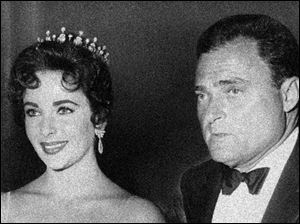 Actress Elizabeth Taylor is shown with her husband Mike Todd in this 1957 file photo.