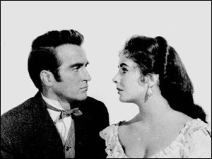 In this 1957 file photo, Elizabeth Taylor poses with Montgomery Clift for the film