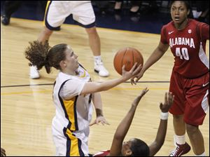 UT's Naama Shafir is fouled by Alabama's Ericka Russell as she drives to the basket. Shafir would have a game-high 19 points.