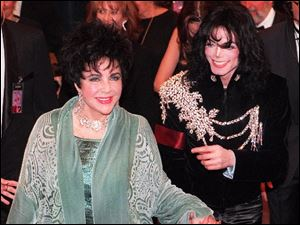Elizabeth Taylor arrives with Michael Jackson at the Pantages Theater in Los Angeles for her birthday celebration Feb. 16, 1997.