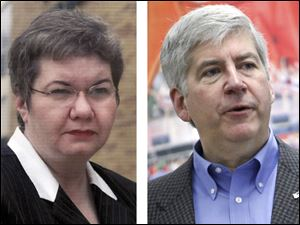 Colleen Jan, left, head of the Bedford Education Association, and Michigan Gov. Rick Snyder.