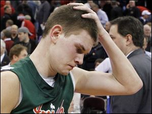 Central Catholic's Drew Lehman is upset after losing to Cincinnati LaSalle.
