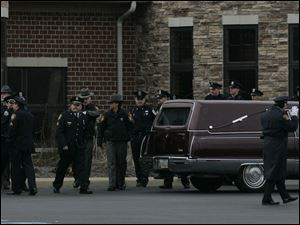 Police from all over Ohio attend the funeral for slain Sandusky police officer Andrew Dunn at The Chapel in Sandusky, Ohio.