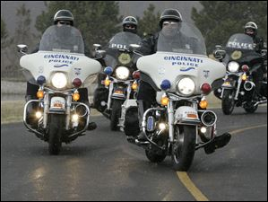 Motorcycle police from Cincinnati attend the funeral for slain Sandusky police Officer Andrew Dunn.