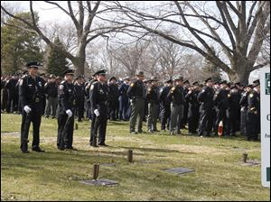 Police from all over Ohio attend the service at Calvary Cemetery Mausoleum in Sandusky, Ohio for slain Sandusky police Officer Andrew Dunn.