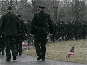 Police from all over Ohio attend the funeral for slain Sandusky police officer Andrew Dunn.