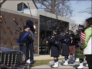Cleveland Police Pipes and Drums perform at the service for slain Sandusky police officer Andrew Dunn at The Chapel in Sandusky, Ohio.