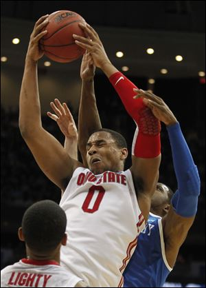 Jared Sullinger led the Buckeyes with 21 points and 16 rebounds against the Wildcats Friday night. This season, he was named the Big Ten freshman of the year and an All-American. He said the loss to Kentucky motivates him to return for another season.