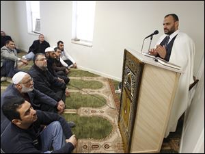Imam Ahmed Abou Seif leads a prayer service at the Toledo Muslim Community Center on West Sylvania Avenue in a building that formerly housed the J. Jeffrey Fretti mortuary.
