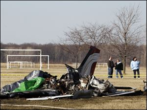 Debris from a plane crash at Munson Park Tuesday, March 29, 2011, in Monroe, Mich..