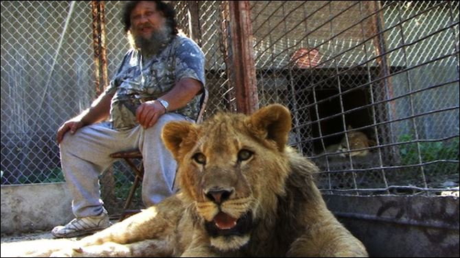 Former truck driver Terry Brumfield raises lions in his rural Pike County home.