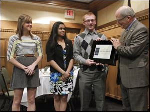 Lake High School students, from left, Hunter Johnson, 17, Amy Patel, 17, and Casey Witt, 18, are presented with a Youth Jefferson Award by David Schlaudecker, executive director of Leadership Toledo, for  work with Students In Action at Lake High School.
