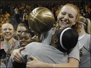 UT seniors Jessica Williams, front, hugs Melissa Goodall after UT defeated USC.