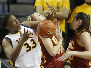 Toledo's Yolanda Richardson (33) grabs a rebound against USC's Christina Marinacci (00) and Kari LaPlante (13).