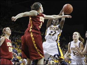 Toledo's Andola Dortch (22) goes to the net against USC's Jacki Gemelos (23).