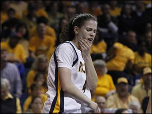 Toledo's Naama Shafir holds her chin after being elbowed by a USC  player.