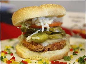 The Flaming Muddy is a deep-fried chicken breast with pepper jack cheese and jalapenos on a bun.