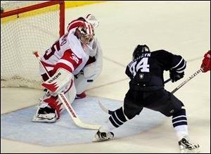 Red Wings goalie Jimmy Howard (35) stops the shot of Predators left wing Sergei Kostitsyn (74) in overtime.