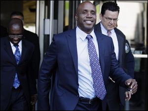 Former baseball player Barry Bonds leaves the federal courthouse for his perjury trial in San Francisco,  Thursday.