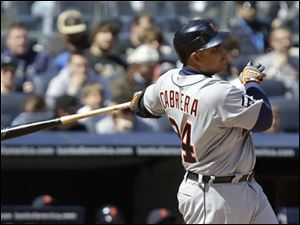 Detroit's Miguel Cabrera follows through on his third-inning, two-run home run, his second of the game, off New York starting pitcher Phil Hughes.