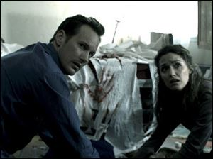 "Patrick Wilson, left, and Rose Byrne are shown in a scene from ""Insidious."""