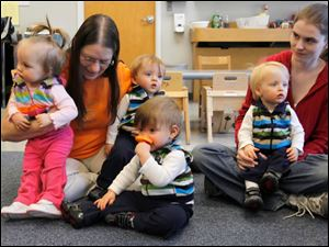 The 15-month old Lake quadruplets, from left, Michaela, James, Dakota and Isaiah, with grandma Linda Hablitzel, left, and mom Lauren visit the Jordan Family Development Center for the first time.