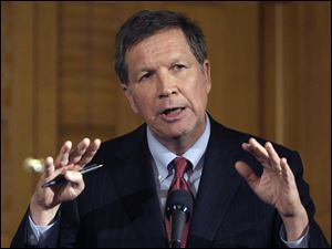Gov. John Kasich proposes a $55.5 billion budget that includes a 50 percent cut in state payouts to local governments. He says it would close an estimated $7.7 billion gap.
