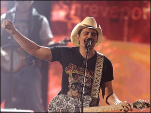Brad Paisley, top male vocalist, helps open the show.