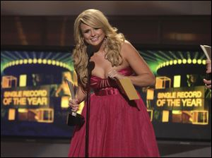 Top female vocalist Miranda Lambert accepts the single record of the year award for 'The House That Built Me.'