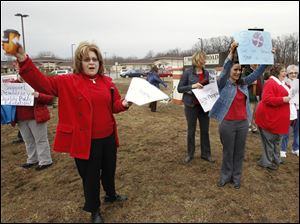 Sandy Taylor, left, a special education teacher at Monroe Road Elementary School, joins the picket.