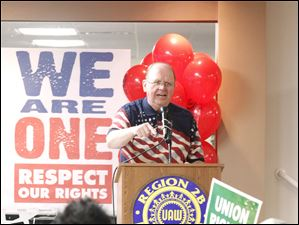 George Tucker addresses the crowd at the UAW Local 14 hall during a