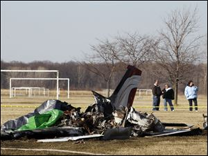 The single-engine plane crashed near the soccer fields at Munson Park in Monroe.