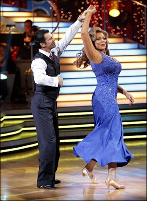 TV personality Wendy Williams, right, and her partner Tony Dovolani perform.