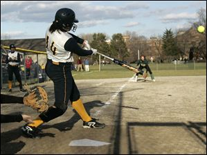 Notre Dame's Cassie Gillespie hits in the winning run during a City League game at Notre Dame Academy in Toledo.