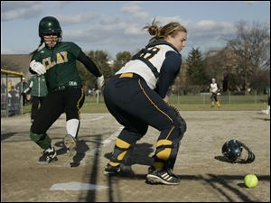 Clay's Cassi Laberdee scores against Notre Dame catcher Bitty Treece.