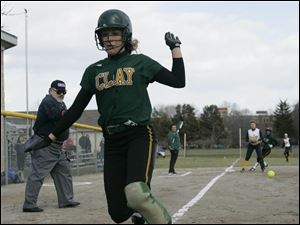 Clay's Kim Crawford comes across home plate.