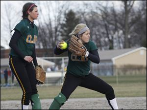 Clay third baseman Brooke Thompson watches pitcher Cassi Laberdee field a grounder.
