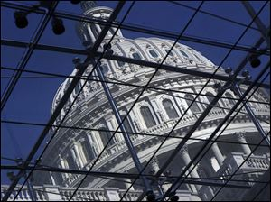 The Capitol dome is seen on Capitol Hill in Washington on Wednesday, as work intensifies in Congress to reach a deal on long-overdue legislation to finance the government through the end of September and avoid a government shutdown.