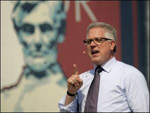 "Conservative commentator Glenn Beck speaks to thousands gathered below the steps of the Lincoln Memorial in Washington during the ""Restoring Honor"" last August."